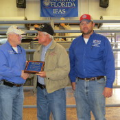 Steve Williams of J & W receiving his plaque for their consignment J&W Mr Cruising that was the winner of the FL Bull Test and SimAngus breed winner. Pictured (from L to R): Nick Comerford (NFREC Center Director), Steve Williams, and David Thomas (NFREC Beef Unit Supervisor).